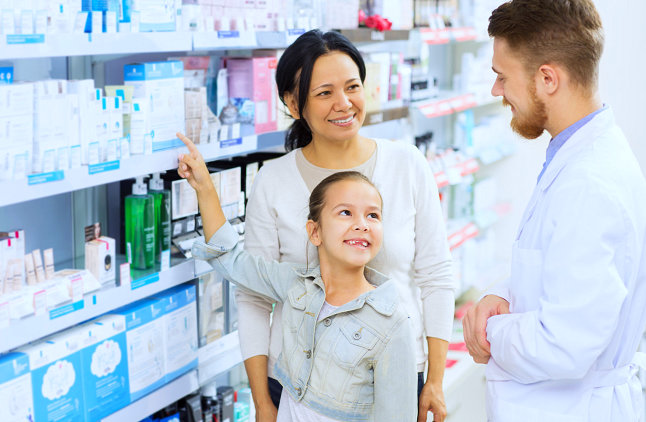 pharmacist and a mother with her kid talking
