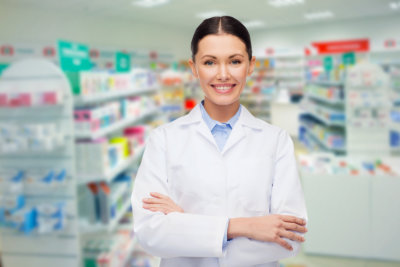 happy young woman pharmacist