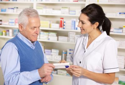pharmacist serving senior man