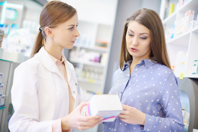 client with pharmacist reading medication labels