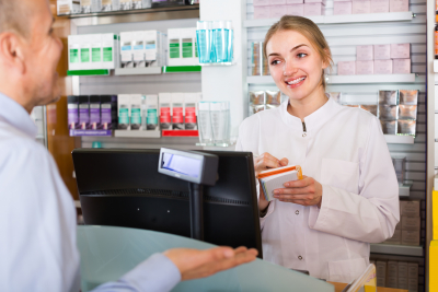 female pharmacist serving and consulting man